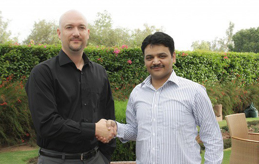 Randall Agee and Raheel Afzal Shake hands in Islamabad, Pakistan 2012